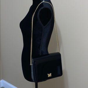 Vintage black patent leather evening bag.